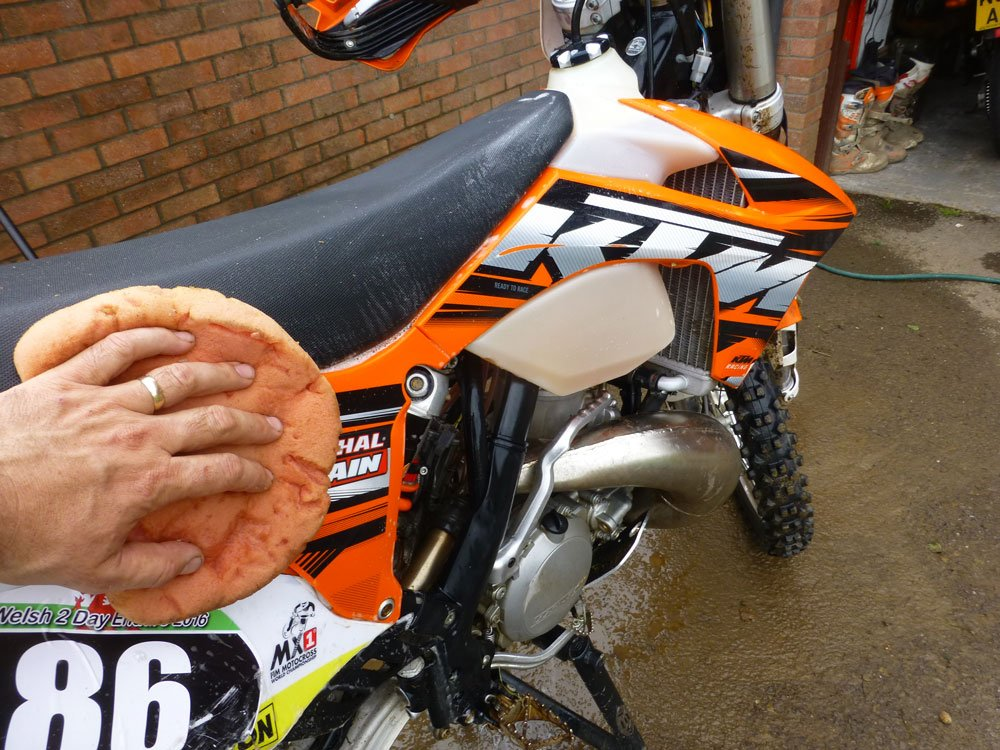 Use a soft sponge on the bikes seat and plastics